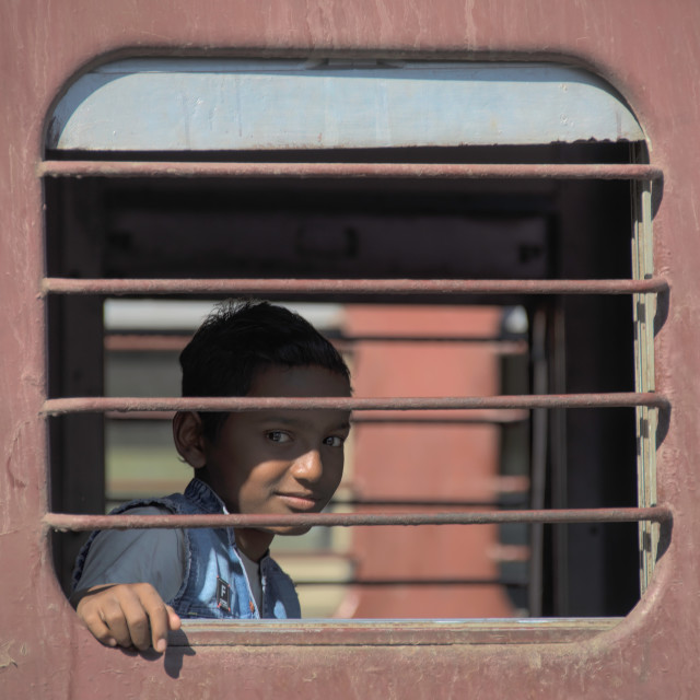 """Indian boy od a train"" stock image"