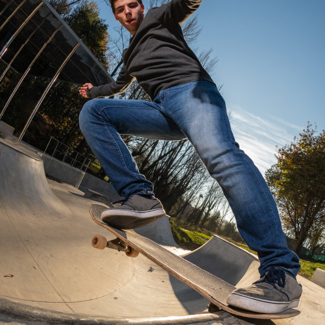 """""""Skateboarder on a tail stall"""" stock image"""