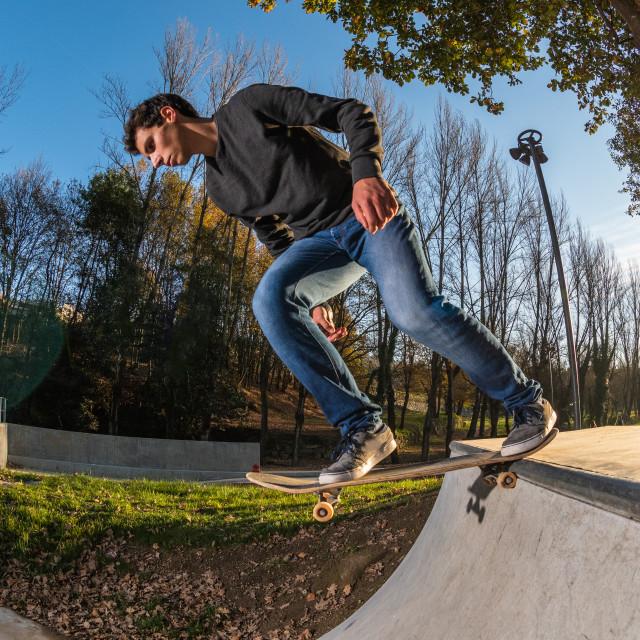 """Skateboarder dropring a ramp"" stock image"