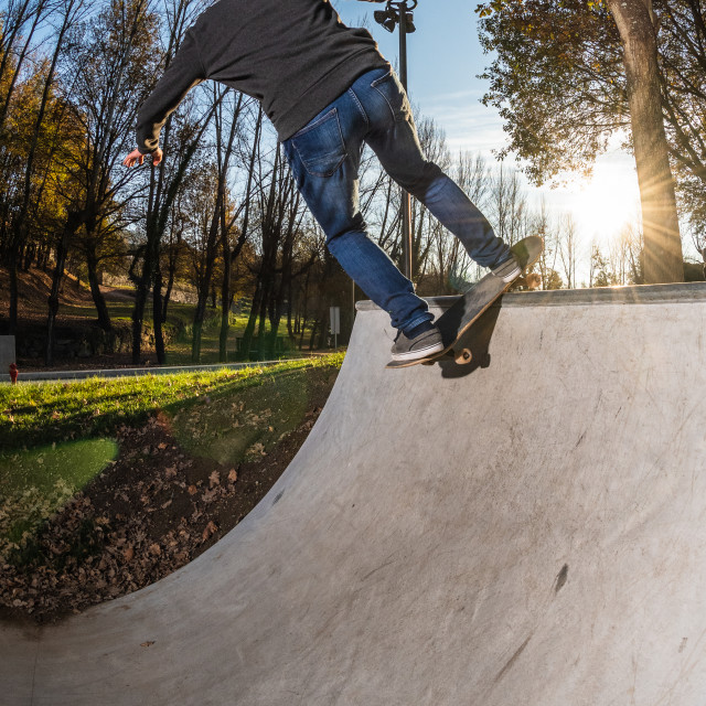 """Skateboarder on a Rock n roll"" stock image"