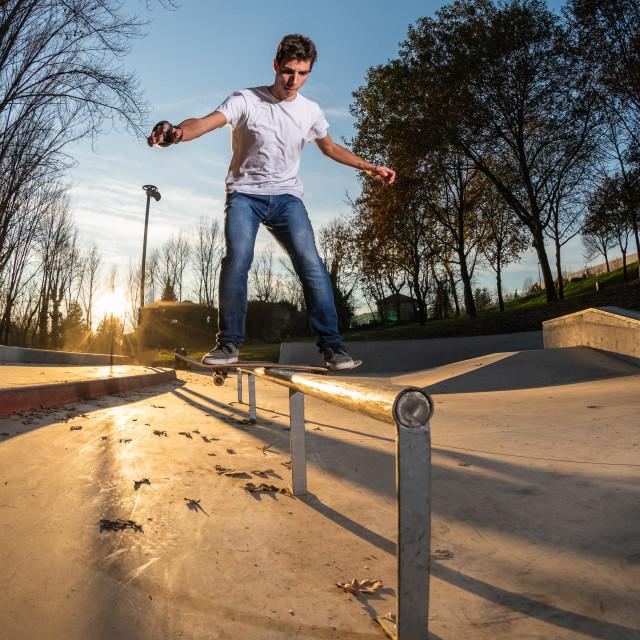 """Skateboarder on a board slide"" stock image"