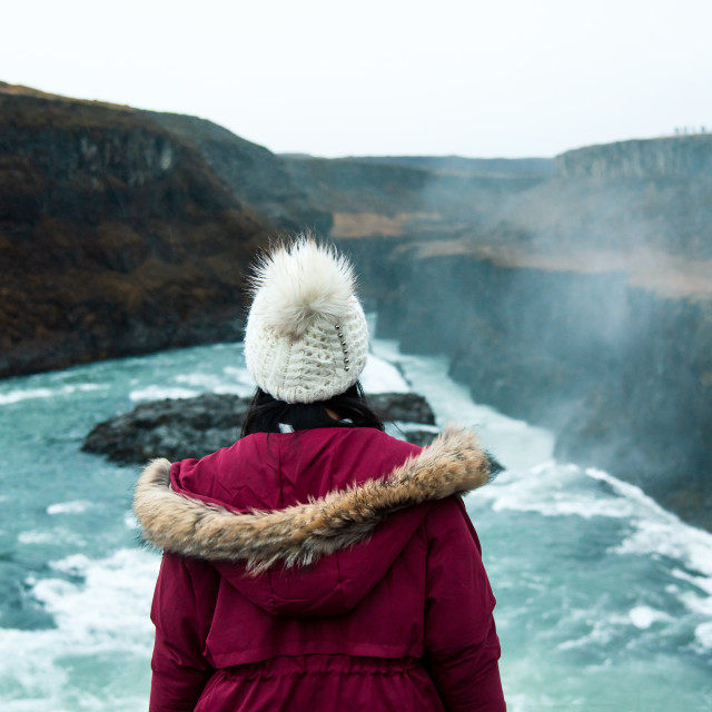 """Female traveler at Gullfoss Falls in Iceland"" stock image"