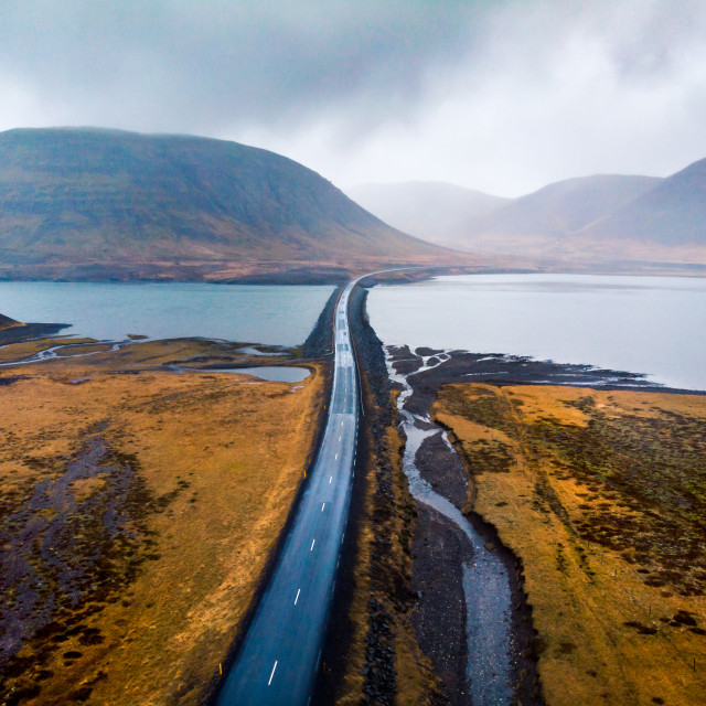 """Scenic road in Iceland surrounded by water aerial view"" stock image"