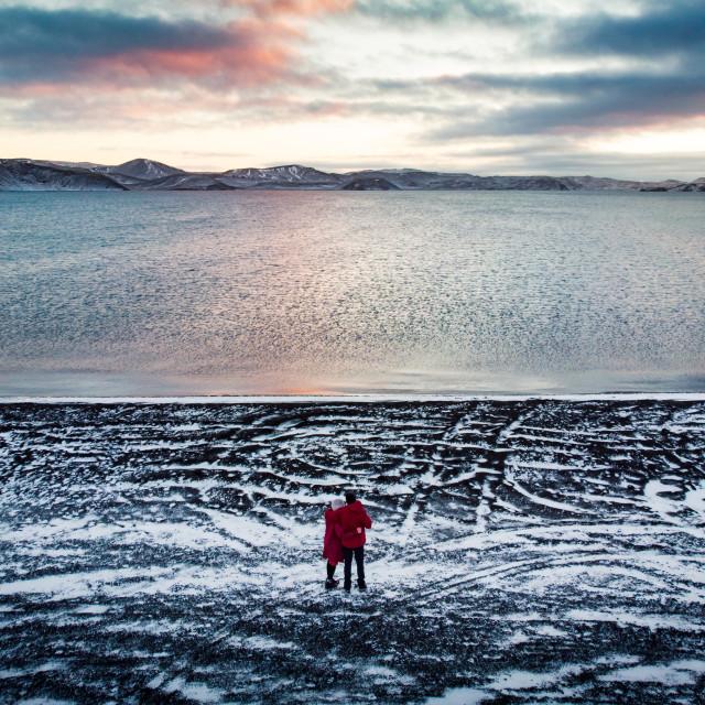 """""""Couple enjoying Kleifarvatn lake view in Iceland"""" stock image"""