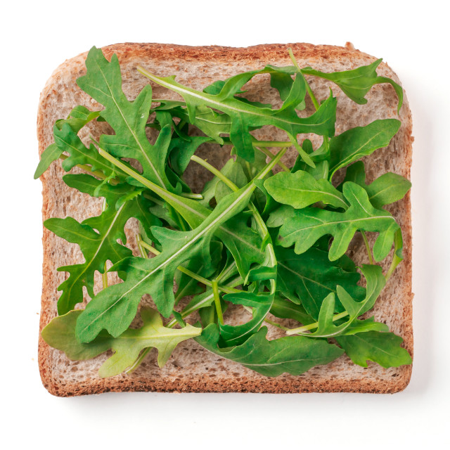 """""""Bread slice with arugula leaves isolated on white"""" stock image"""