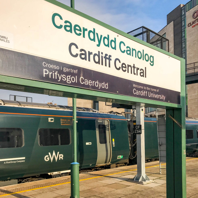 """Station name sign on Cardiff Central station and train"" stock image"