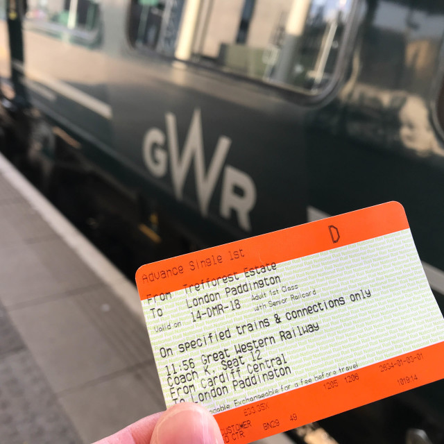 """Rail ticket with a Great Western Railway train in the background"" stock image"