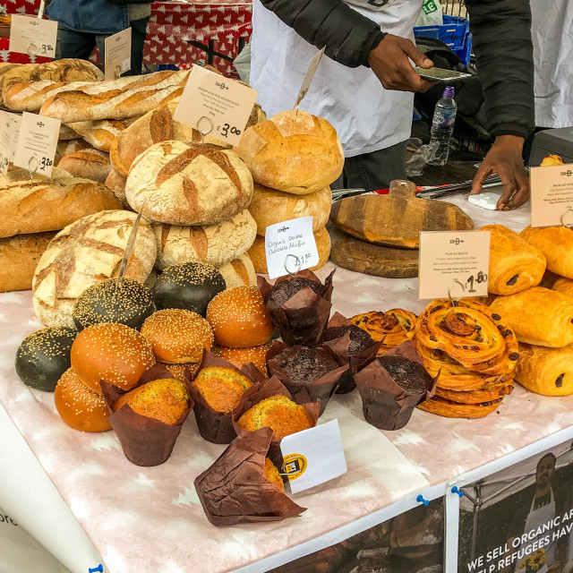 """Bread and pastries on display on a market stall"" stock image"