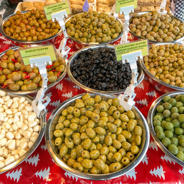 """Bowls of olives on sale on a market stall"" stock image"