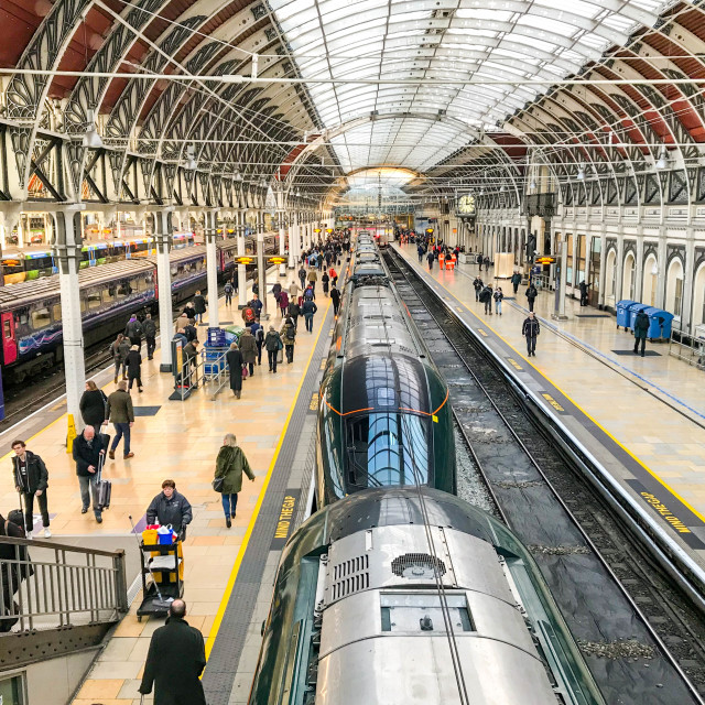 """Passengers walking along a platform in London Paddington Station"" stock image"