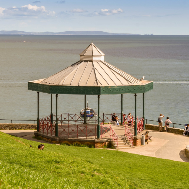 """""""Bandstand and people on the coastal path in Tenby, West Wales."""" stock image"""