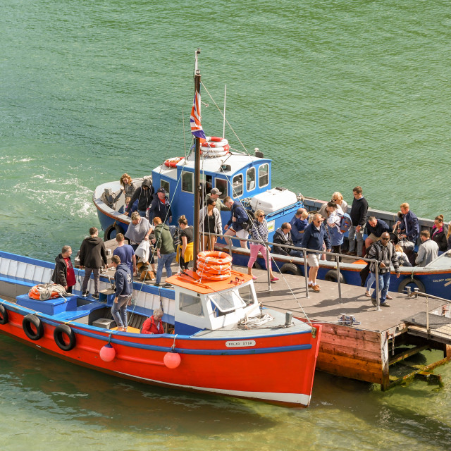 """""""People getting off small boats in Tenby, West Wales."""" stock image"""