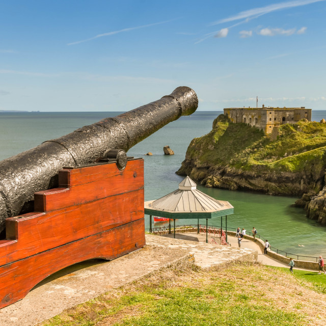 """""""Ancient cannon overlooking St Catherine's Island in Tenby, West Wales."""" stock image"""