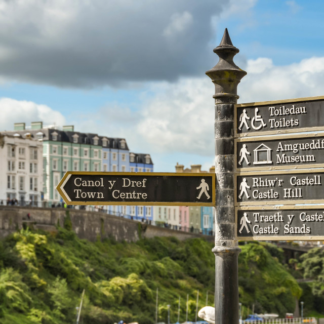 """""""Tourist information in Tenby, West Wales."""" stock image"""