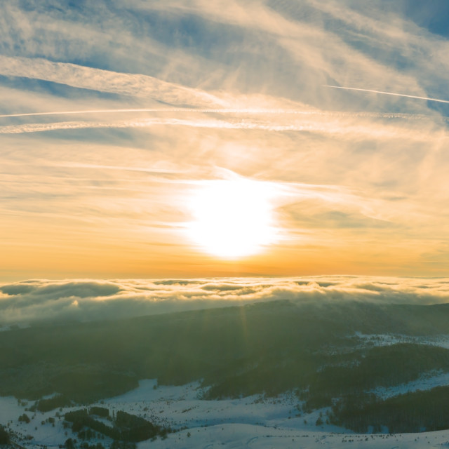"""""""Aerial view of a gold sunset over winter snow. Panorama."""" stock image"""