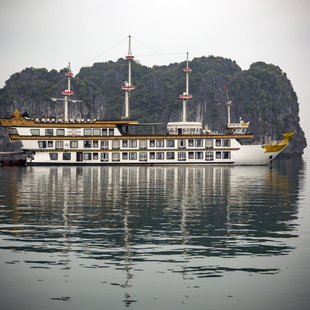 """Dragon Legend Chinese junk and limestone (Karst) formation, Ha Long Bay, Vietnam"" stock image"