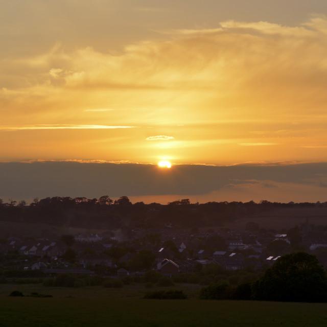 """Sunset Over Rural Village"" stock image"