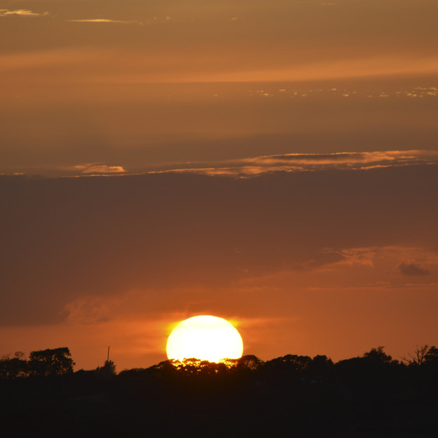 """Setting Sun and Deep Orange Sky"" stock image"