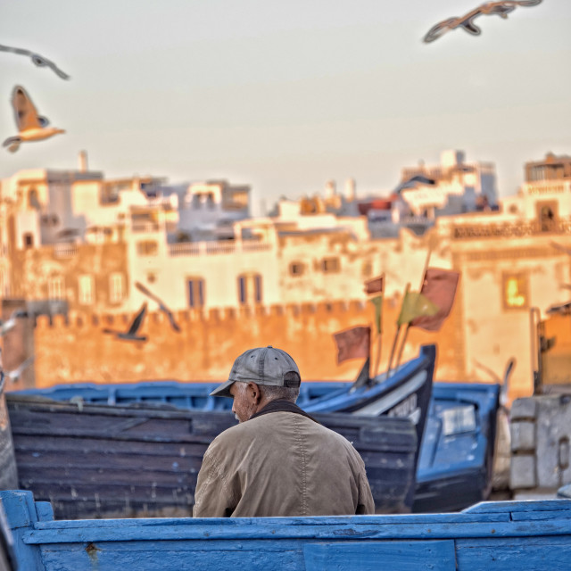 """Lone fisherman - Essaouira port, Morocco"" stock image"