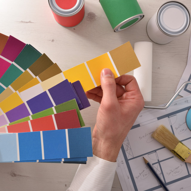 """""""Decorator choosing a color for interior housing project top view"""" stock image"""