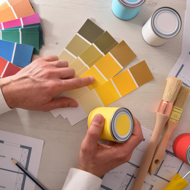 """""""Decorator choosing a color for interior housing project top"""" stock image"""
