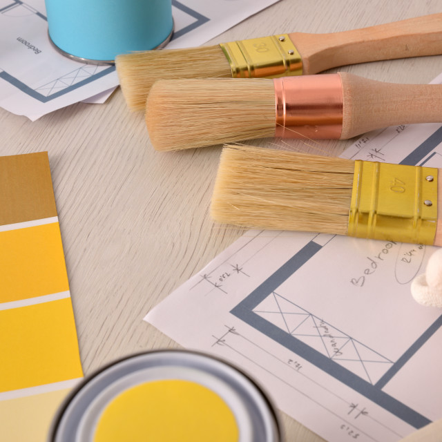 """""""Decorator table with painting project and tools background elevated view"""" stock image"""