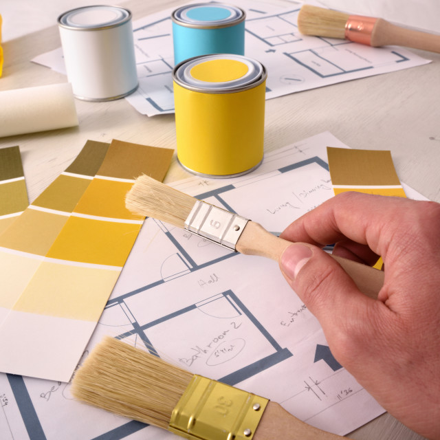 """""""Decorator working for an interior housing painting project"""" stock image"""