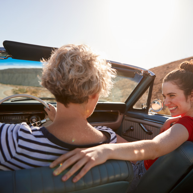 """""""Mum and adult daughter in open top car, back view, close up"""" stock image"""