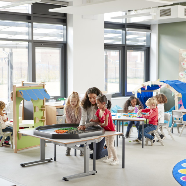 """""""Kids playing games with a female teacher in a classroom in an infant school,..."""" stock image"""