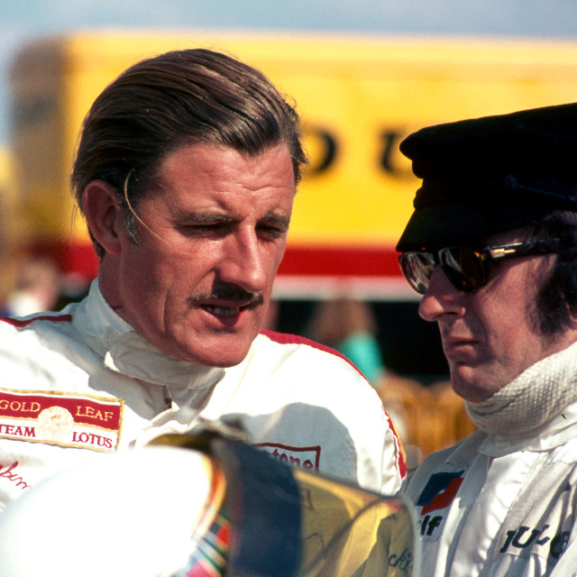 """""""Graham Hill and Jackie Stewart in conversation"""" stock image"""