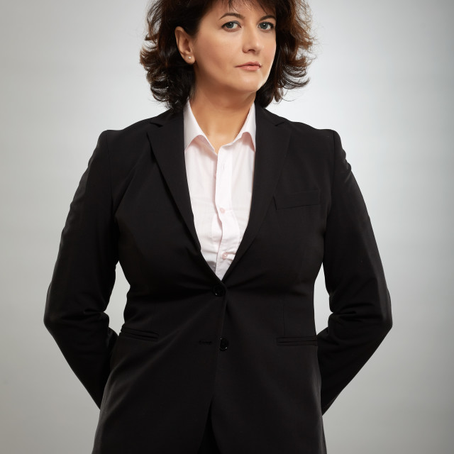 """""""Mature businesswoman on gray background"""" stock image"""