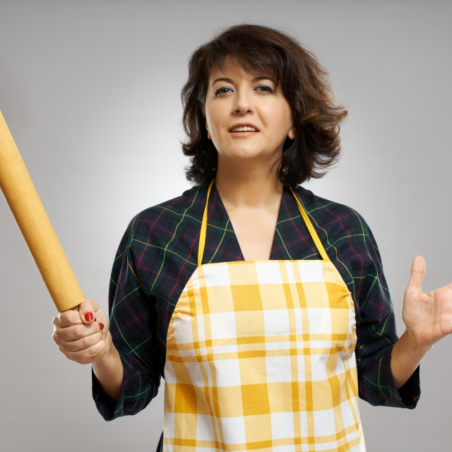 """""""Baker lady with a rolling pin"""" stock image"""