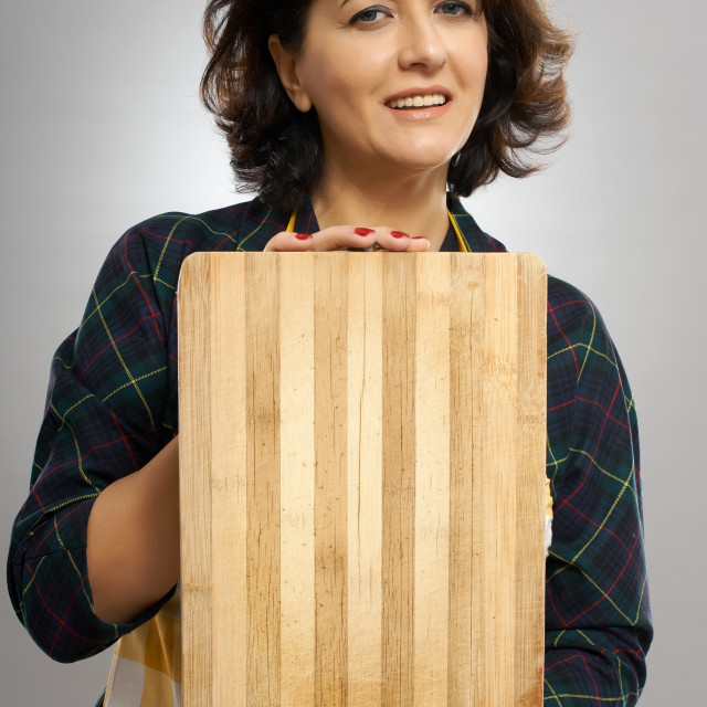 """""""Woman holding a wooden board"""" stock image"""
