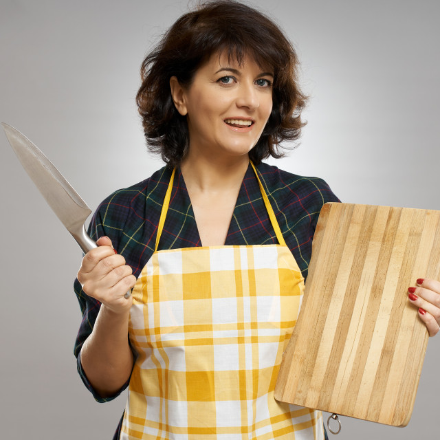 """""""Woman with knife and wooden board"""" stock image"""