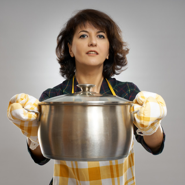 """""""Housewife holding a pot"""" stock image"""