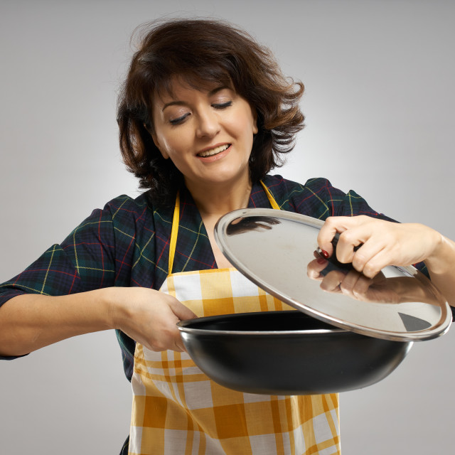 """""""Woman cook holding a pan"""" stock image"""