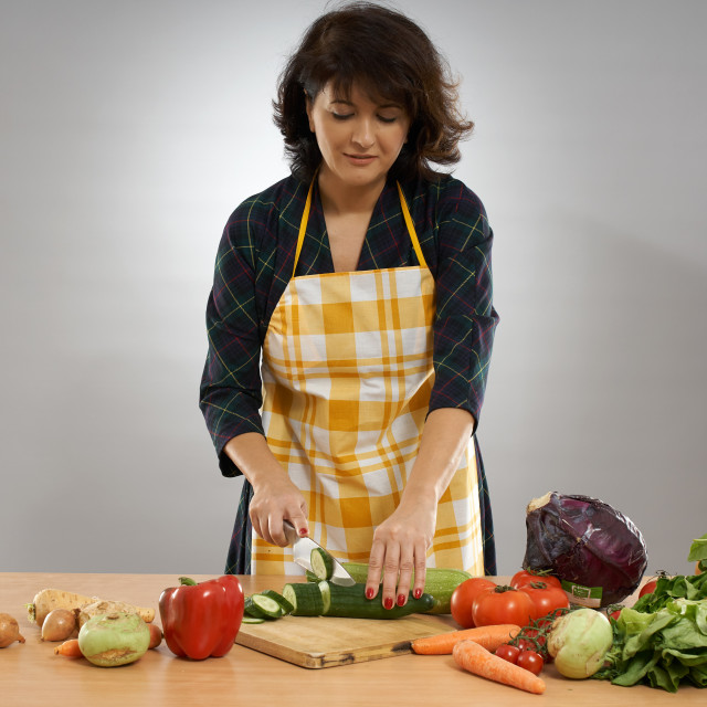 """""""Woman chopping vegetables"""" stock image"""