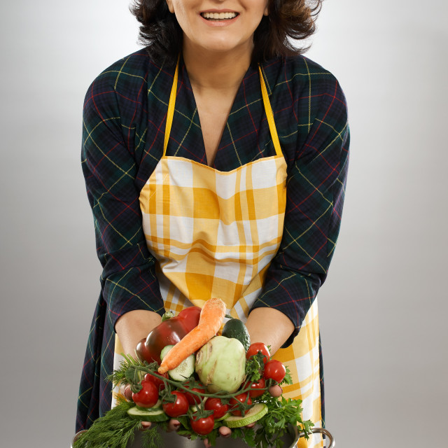 """""""Woman with vegetables and pot"""" stock image"""