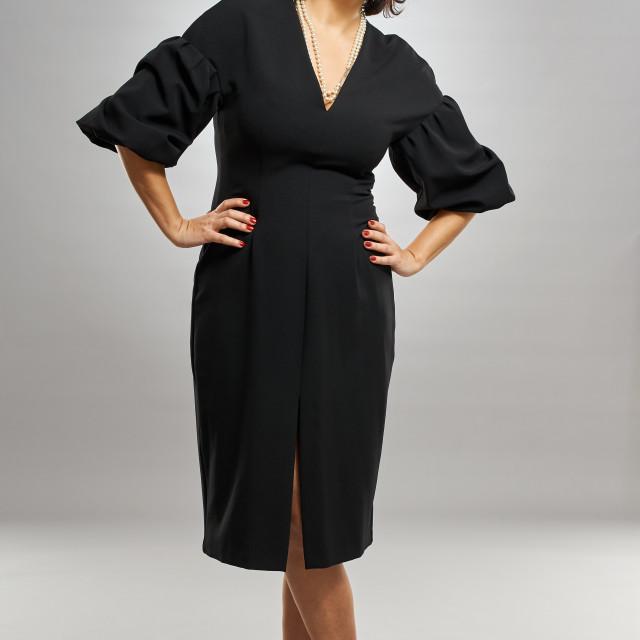 """Businesswoman in black dress"" stock image"