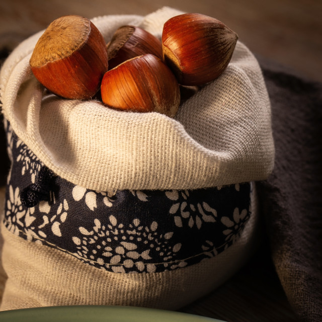 """""""Several whole brown hazelnuts placed in linen bag"""" stock image"""