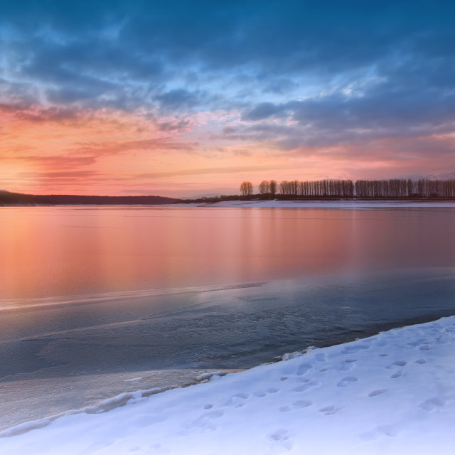 """Incredibly beautiful sunset.Sun, sky,lake.Sunset or sunrise landscape, panorama of beautiful nature. Sky with amazing colorful clouds. Water reflections.Magic Artistic Wallpaper.Dream, line.Creative Winter Background."" stock image"