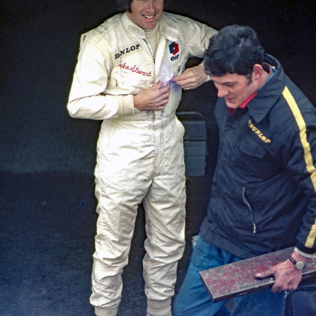"""""""Jackie Stewart jokes with a mechanic Brands Hatch Garages"""" stock image"""