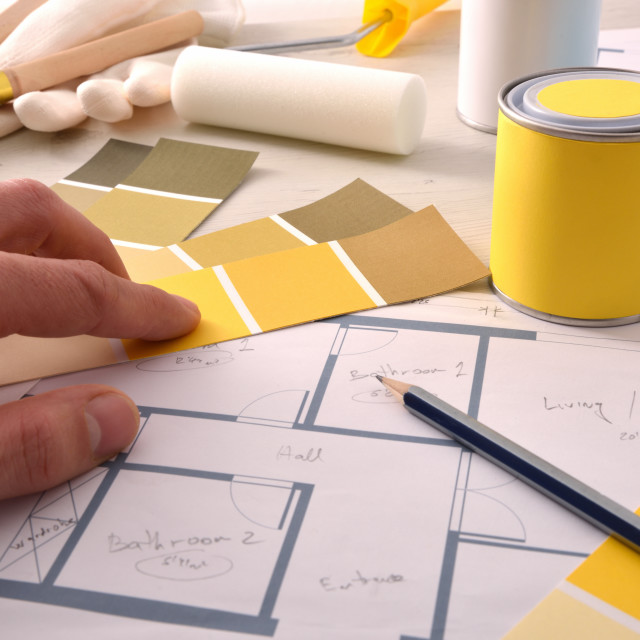 """""""Decorator choosing yellow color for interior home painting project"""" stock image"""
