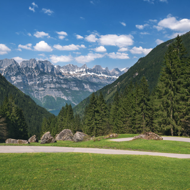 """Alpine road in the Swiss Alps on a sunny day"" stock image"
