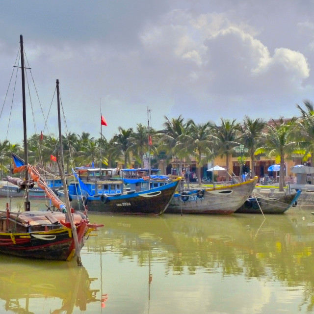 """Fishing boats in Hoi An, Vietnam"" stock image"