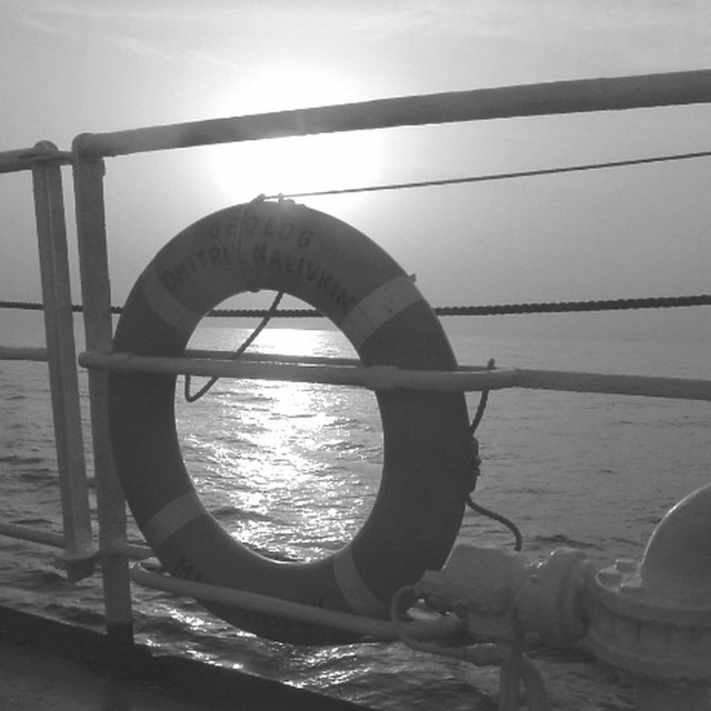 """sunset offshore from a vessel in black & white"" stock image"