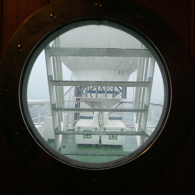 """offshore Gabon through a porthole"" stock image"