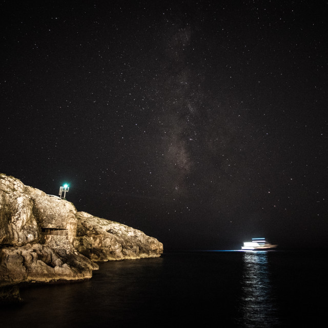 """Boat under starry sky"" stock image"