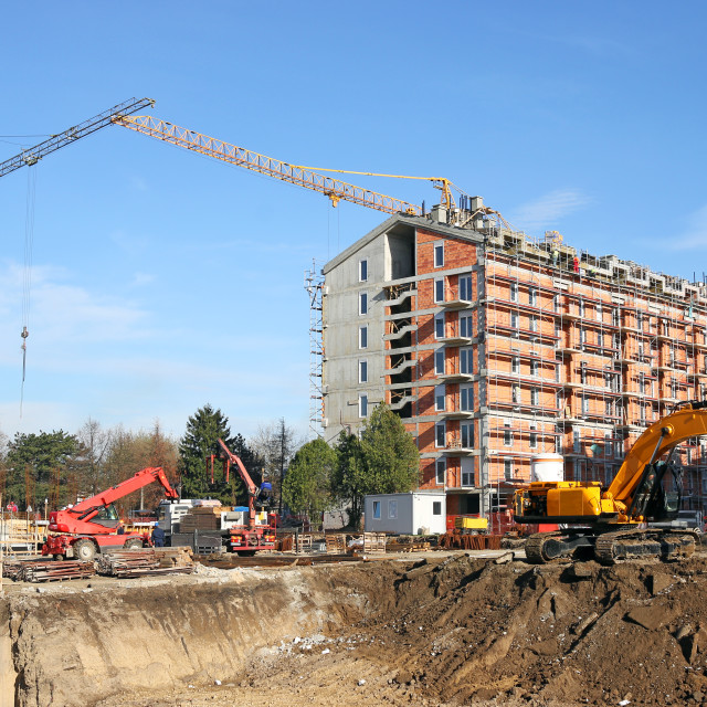 """""""new building construction site with workers cranes and excavator"""" stock image"""