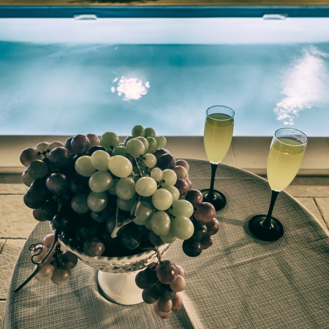 """""""Drink and grape near the pool"""" stock image"""